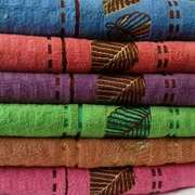 Домашний текстиль,  полотенца,  пледы.